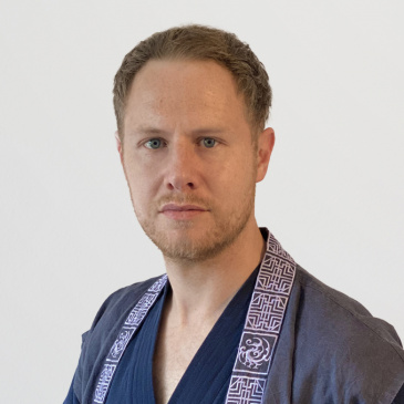 Instructor Tim Olbrich from Germany is promoted to a Kummooyeh master
